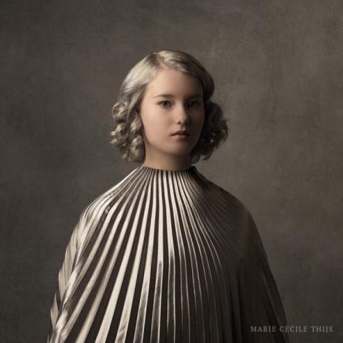 Girl in Silver Cape